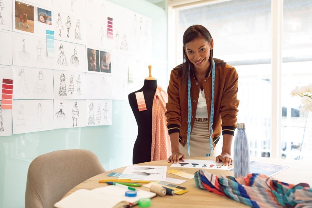 Female fashion designer working on her collection